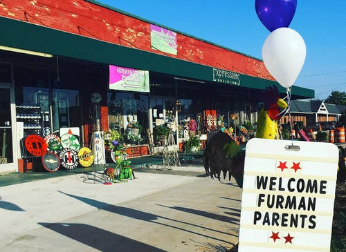 Welcome Furman Parents, reads the sign outside our Greenville storefront