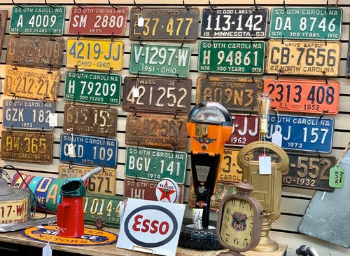 Unique finds, like these used license plates and street meters, can be found at our Landrum antique store